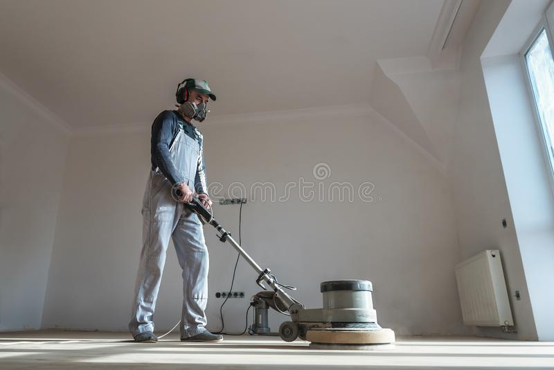 The professional master polishes the parquet royalty free stock photos