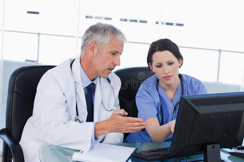 Download Professional Medical Team Working With A Computer Stock Photo - Image: 22692768