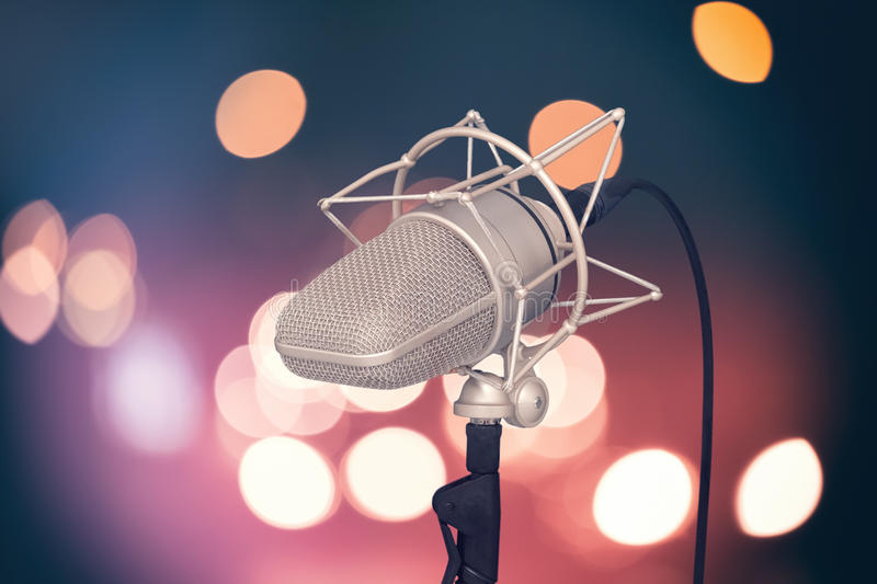 Professional microphone on bright colored background, mic stock image