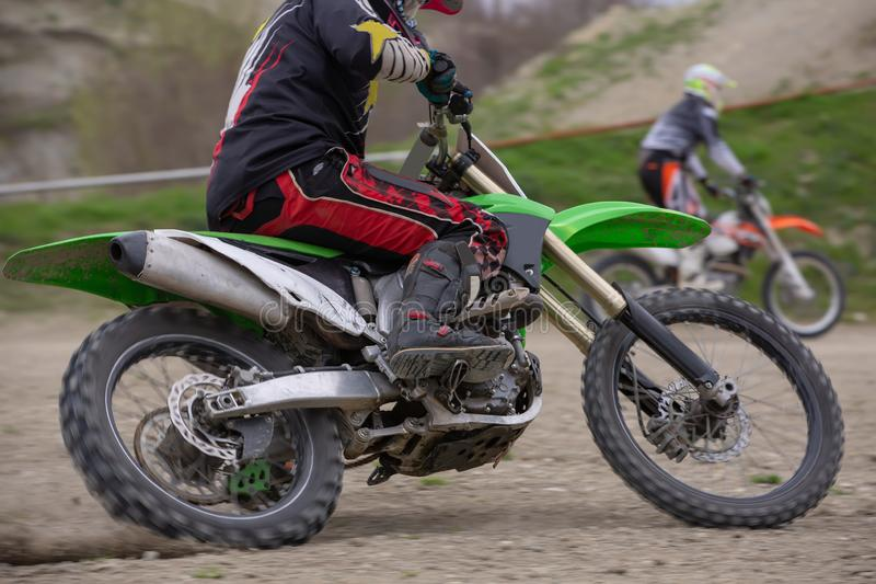 Professional Motocross Motorcycle Rider Drives Over the Road Track. royalty free stock photos