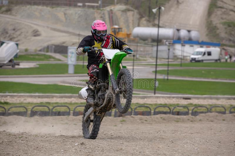 Professional Motocross Motorcycle Rider Drives Over the Road Track. stock images