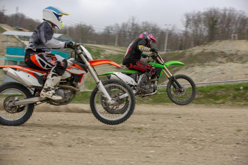 Professional Motocross Motorcycle Rider Drives Over the Road Track. stock photography