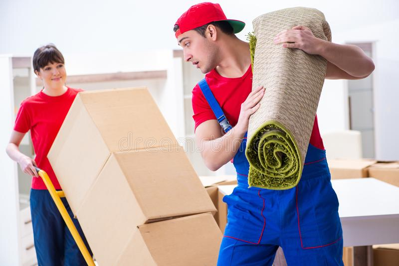 The professional movers doing home relocation royalty free stock photography