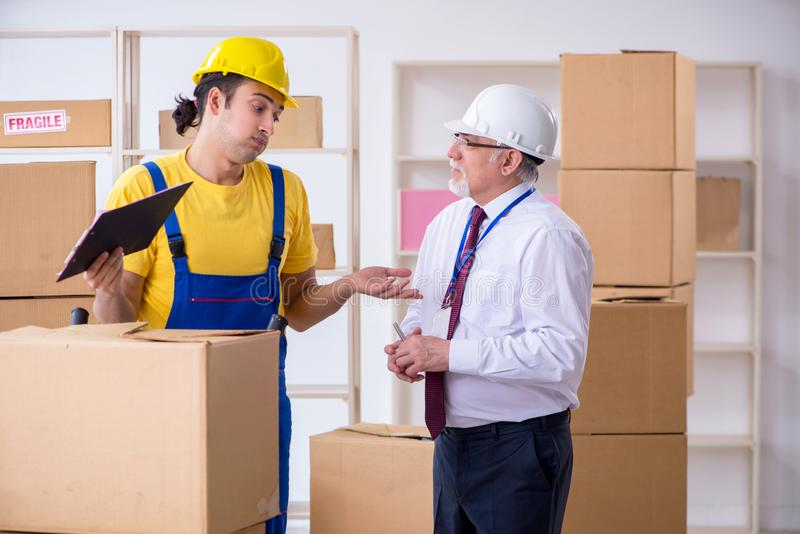 Professional movers doing home relocation royalty free stock images