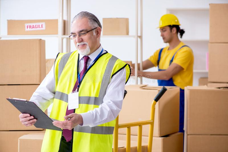 Professional movers doing home relocation royalty free stock image