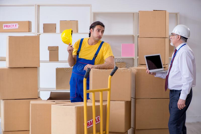 Professional movers doing home relocation stock photo