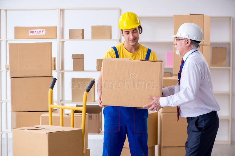 Professional movers doing home relocation. The professional movers doing home relocation royalty free stock photos