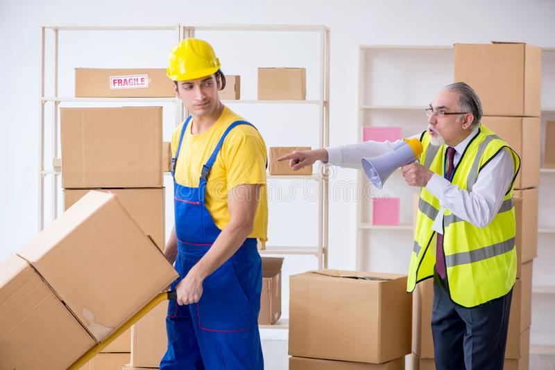 Professional movers doing home relocation. The professional movers doing home relocation royalty free stock images
