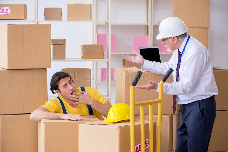 Professional movers doing home relocation. The professional movers doing home relocation stock image