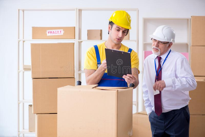 Professional movers doing home relocation stock photos
