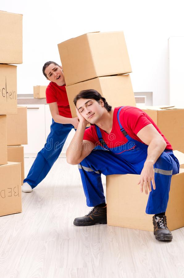 The professional movers doing home relocation royalty free stock photo