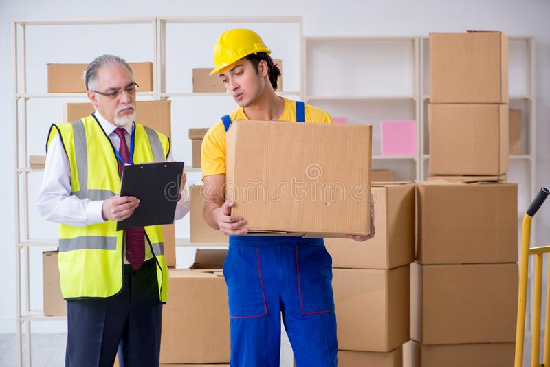 Professional movers doing home relocation royalty free stock photo