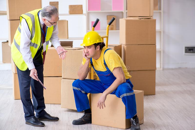 Professional movers doing home relocation royalty free stock photography