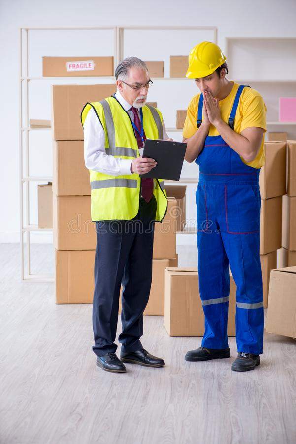 Professional movers doing home relocation. The professional movers doing home relocation royalty free stock image