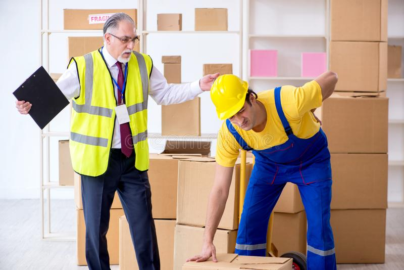 Professional movers doing home relocation. The professional movers doing home relocation stock photography
