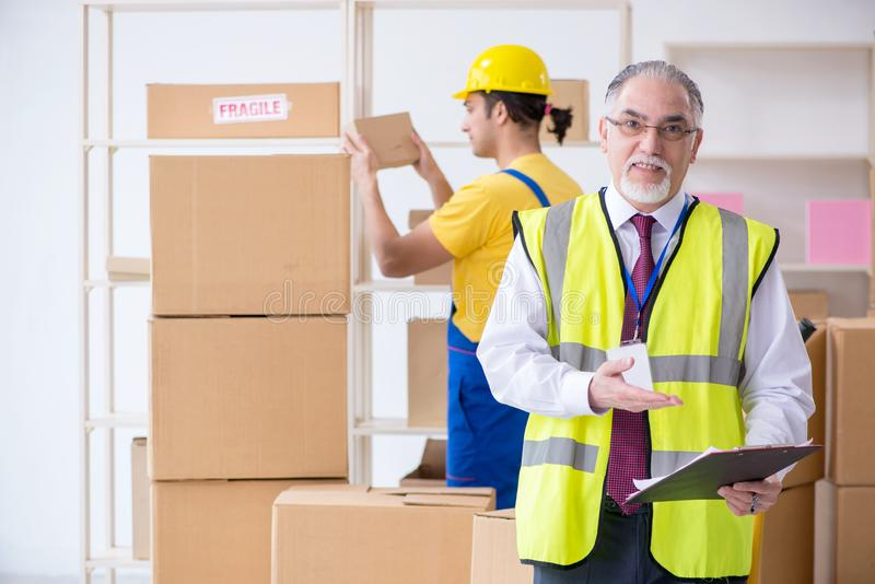 Professional movers doing home relocation stock photography