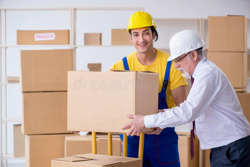 Professional movers doing home relocation royalty free stock photos