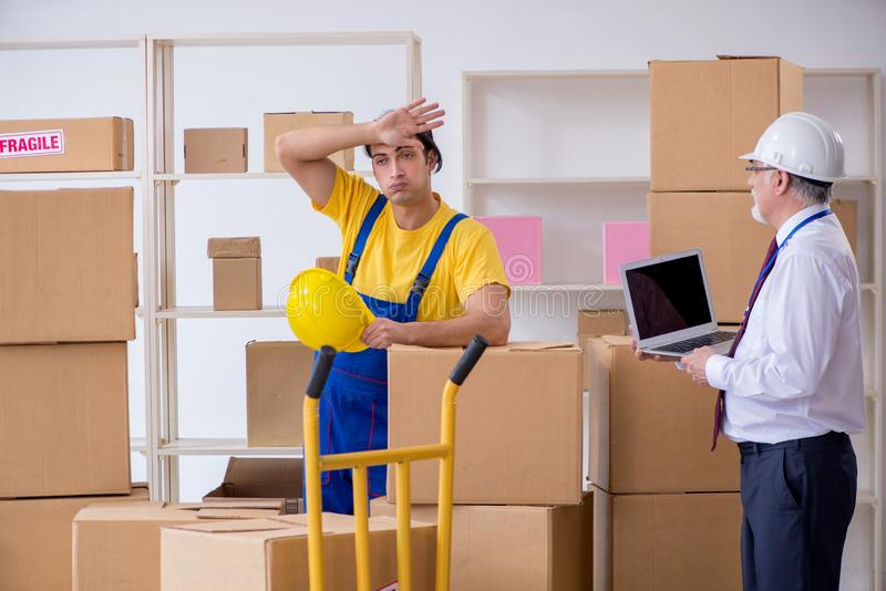 Professional movers doing home relocation stock image