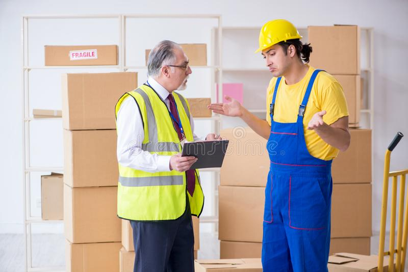 Professional movers doing home relocation stock images