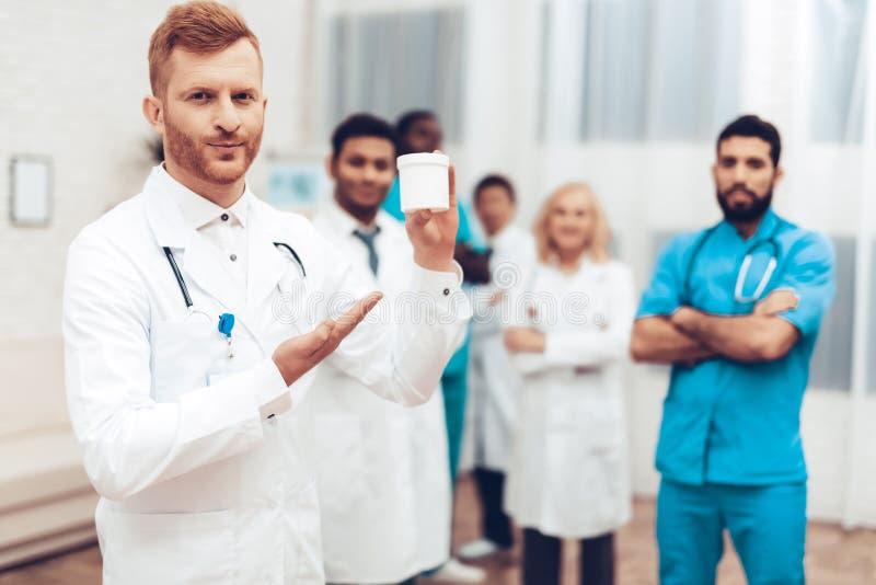Professional Multinational Doctors Camera Posing. stock photos