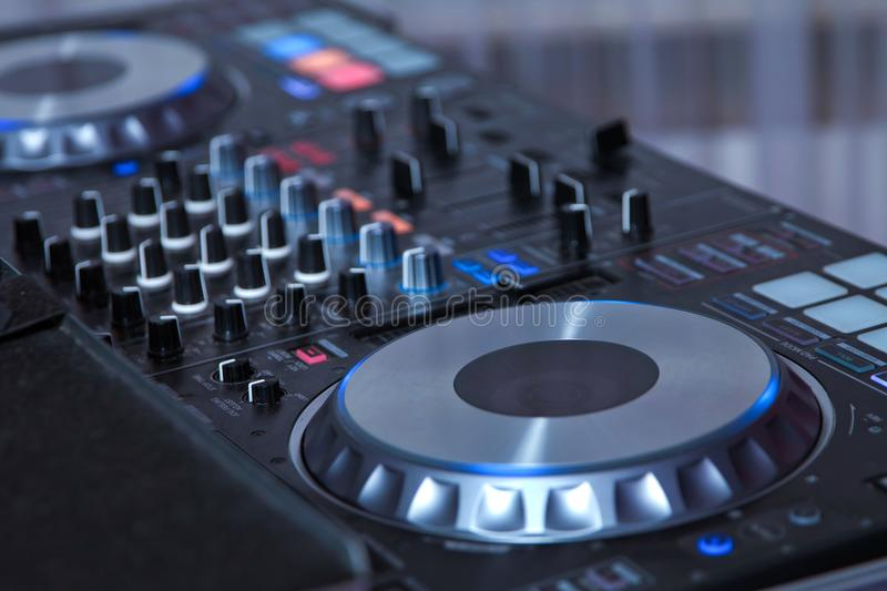 professional music equipment for playing and control music in nightclub with hands DJ . Dj mixes the track in the nightclub at par stock image