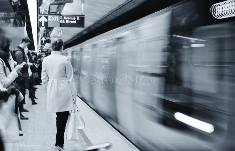 Professional New York City Woman Commute to Work Subway Platform Train Arriving MTA Station Manhattan NYC Transit royalty free stock photos