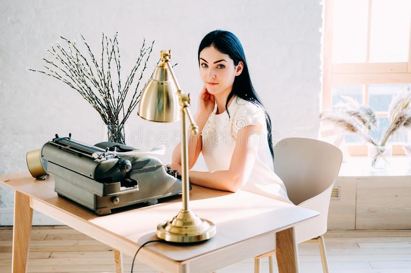 Professional occupation. Secretary in white dress typing documents royalty free stock photos