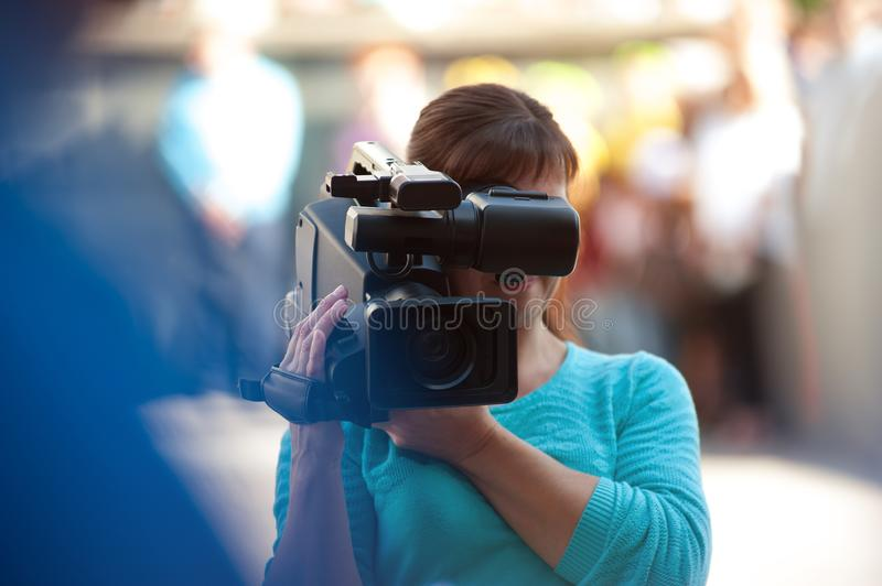 Professional operator with a video camera at work. stock image