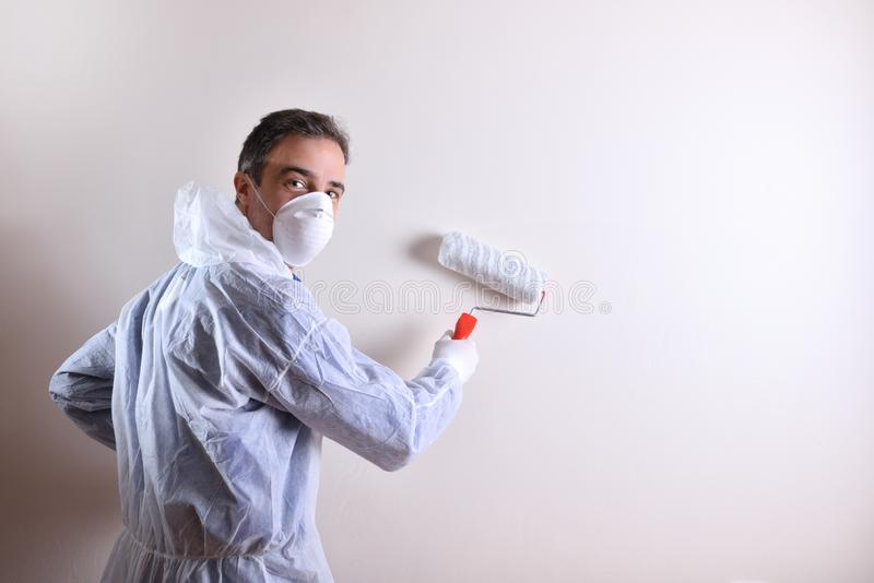 Professional painter on a wall looking in the back royalty free stock photography