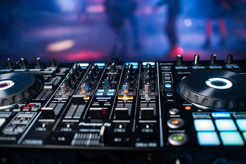 Professional panel of DJ console for mixing music in nightclub at party stock image