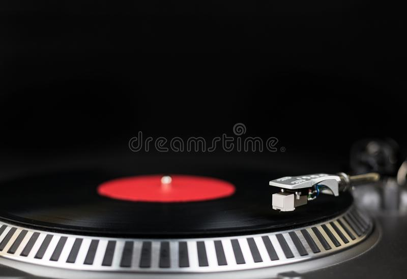 Professional party djs turntable close-up shot. Analog stage audio equipment for concert in nightclub. Play mix music stock images