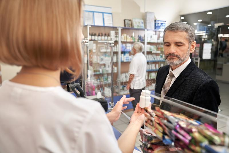 People choosing, bying medicaments in drugstore. royalty free stock photography