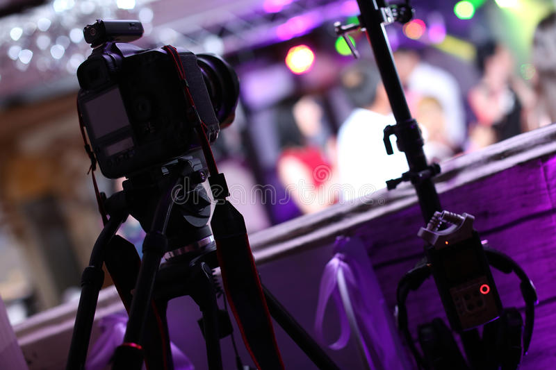Professional photo camera at an event royalty free stock image