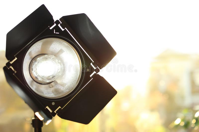 Professional photo studio lighting equipment on blurred background. royalty free stock image