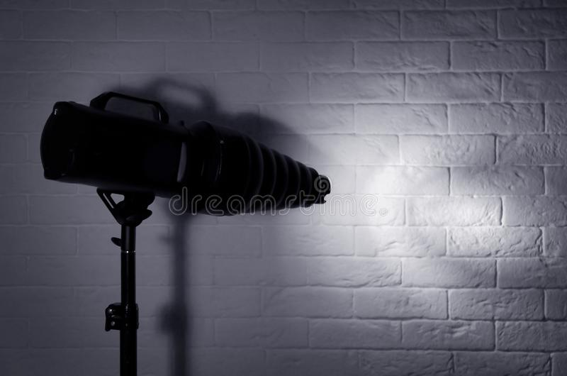 Professional photo studio lighting equipment near brick wall stock photography