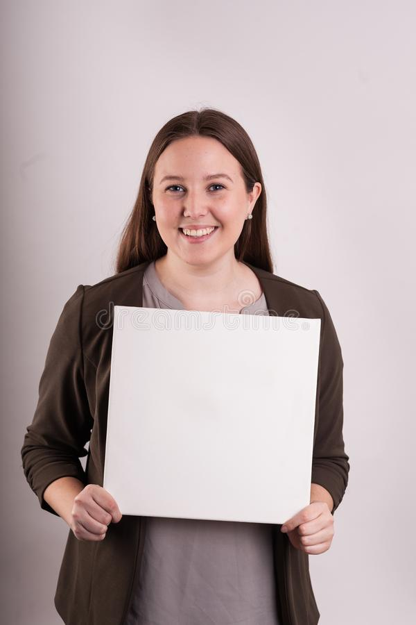 Portrait of professional women holding a blank sign royalty free stock photo