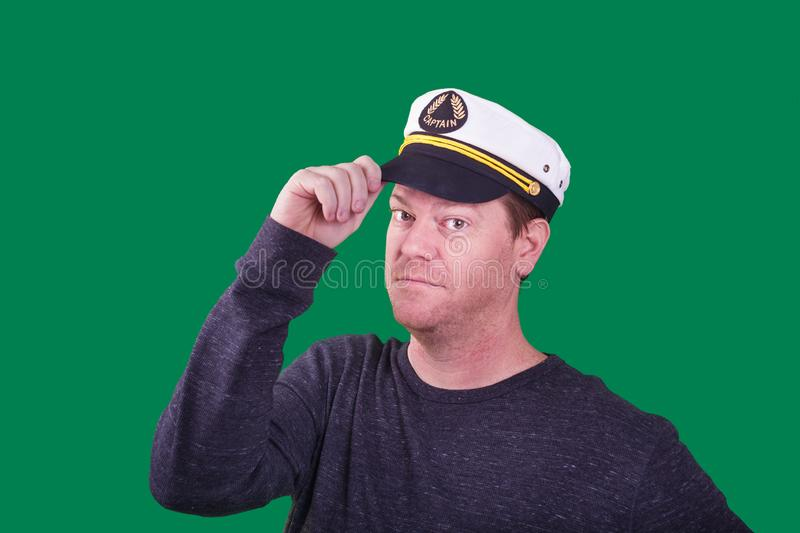 Middle aged man wearing a captains hat captured on green screen stock image