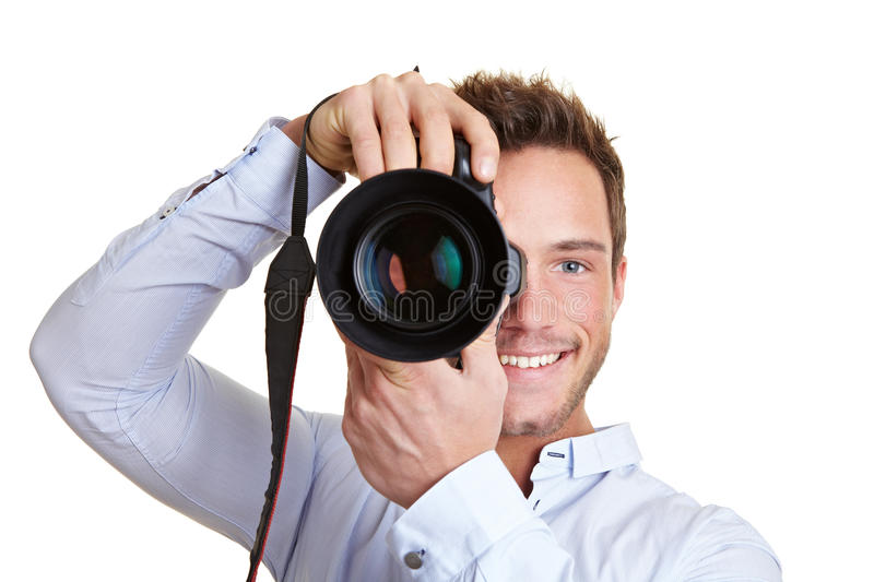 Professional photographer. Happy professional photographer with digital DSLR camera royalty free stock photography