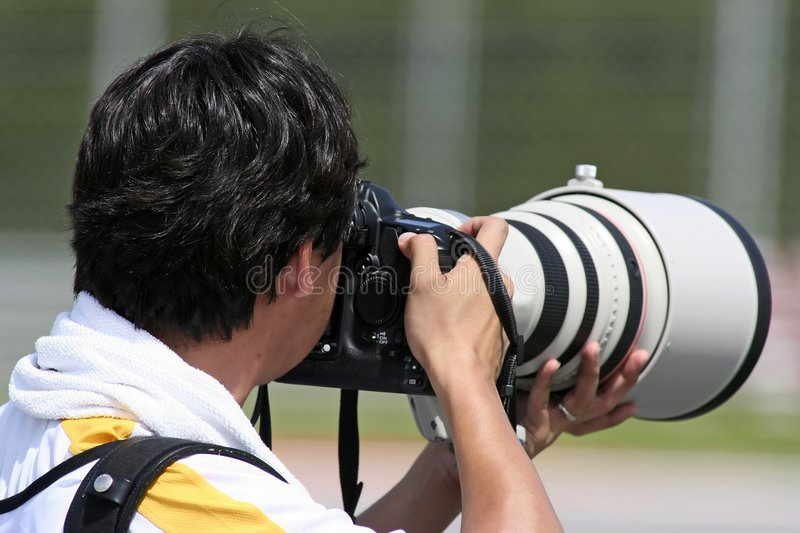 Professional Photographer. In action stock photo