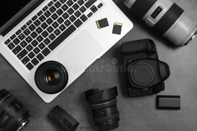 Professional photographer equipment and laptop on gray background. Top view royalty free stock photos