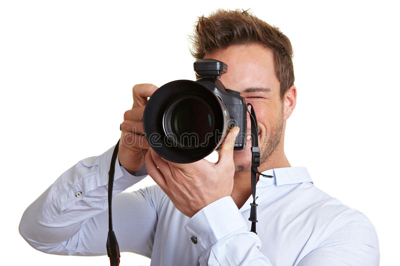 Professional photographer looking. Professional photographer taking pictures with digital DSLR camera stock photography
