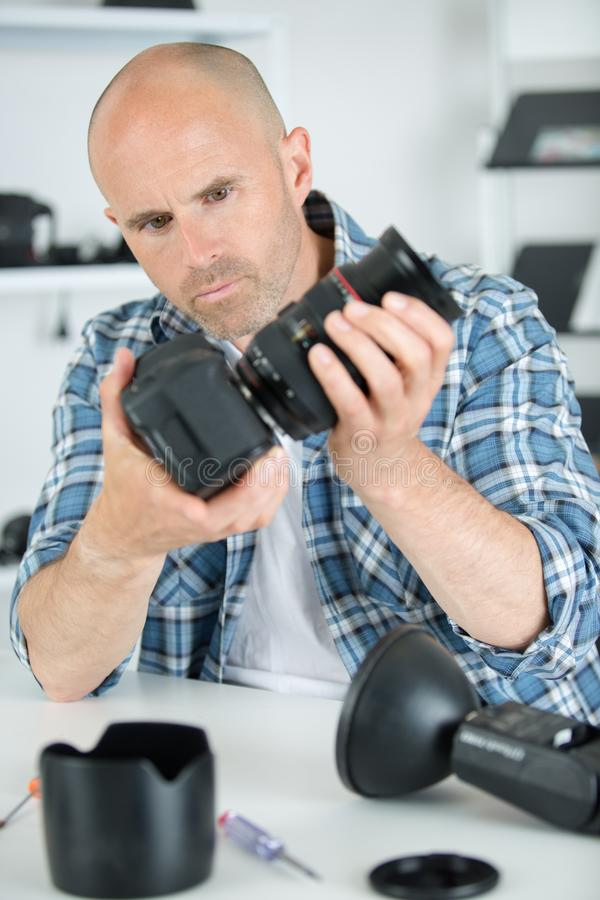 Professional photographer man holding camera with macro len royalty free stock photos