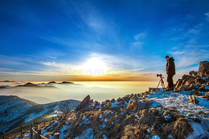 Professional photographer takes photos with camera on tripod. stock photography