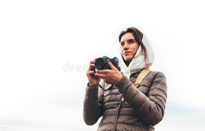 Professional photographer tourist traveler standing on on a white background holding in hands digital photo camera, hiker view stock photos