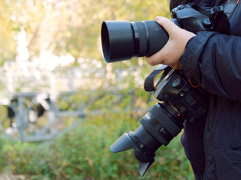 Professional photographic equipment in the hands of the photographer stock images