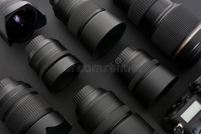 Professional photographic equipment. Large collection of professional and modern photographic equipment on a black background low key royalty free stock photo