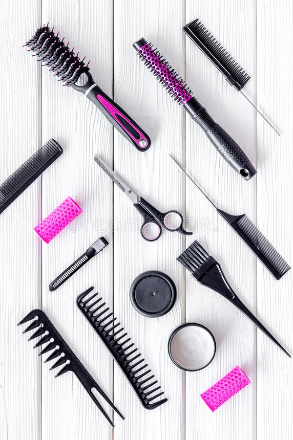 Professional pink accessories of hairdresser with combs on work desk wooden white background top view pattern. Hair cut concept. Professional pink accessories of royalty free stock photos