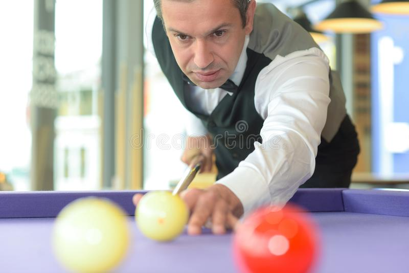 Professional player at pool table royalty free stock photos