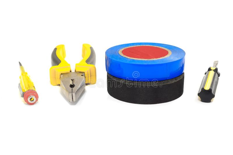 Pliers, screwdriver set and electrical tape. Professional Pliers, screwdriver set and electrical tape black and blue royalty free stock photos