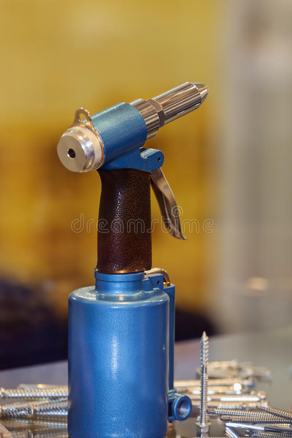 Professional pneumatic tool. Focus on new professional pneumatic tool; note shallow depth of field stock image